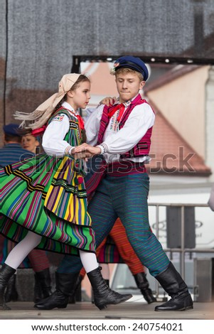 Lowicz, Poland, May 30, 2013: Groups of folk dancers from the city of Lowicz in central Poland. Dancers present folk dance and are dressed in colorful traditional costumes.