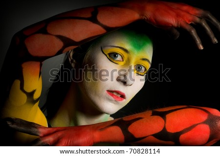 lowkey bodypainting with high contrast in colour yellow red and green