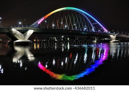 Lowry Avenue Bridge in Minneapolis lit in Rainbow Colors in Honor of Orlando Victims - stock photo