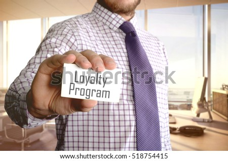 Loyalty program on the card shown by a man