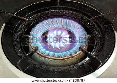 LPG Gas Burner hot blue fire flames from a stove for cooking in a kitchen - stock photo