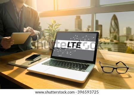 LTE CONCEPT Thoughtful male person looking to the digital tablet screen, laptop screen,Silhouette and filter sun - stock photo