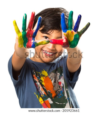Lttle asian boy with hands painted in colorful paints, Isolated over white - stock photo