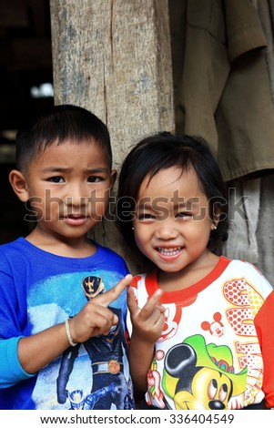 LUANG NAMTHA,LAOS-OCTOBER 06, 2015:  Local come to receive visits by tourists out of curiosity on October 06, Luang Namtha, Laos.