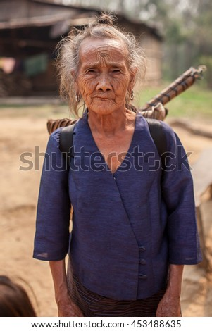 LUANG PRABANG, LAOS - APRIL 8, 2013: Unidentified Hmong tribe woman in a village near Luang Prabang, Laos on 8 April 2013.