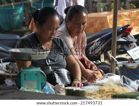 LUANG PRABANG, LAOS - August 15th: A typical scene of Laotian women selling produce at the local markets of Luang Prabang, Laos on the 15th August, 2014.