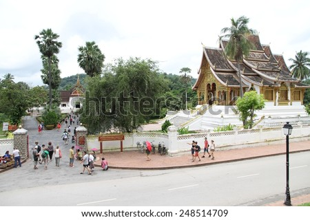 LUANG PRABANG, LAOS - AUGUST 14: The busy entrance to the Royal Palace Museum in the town of Luang Prabang, Laos on the 14th August, 2014.