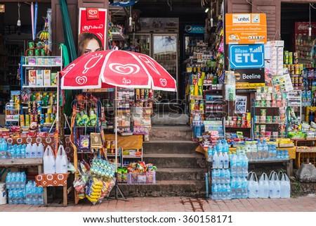 Luang Prabang, Laos - December 21, 2015: A famous mini-mart on the local walking street of Luang Prabang, Laos. - stock photo