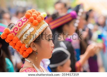Luang Prabang, Laos - December 20, 2015: Woman of local mountaineer tribe 'Hmong' is dressing with traditional costume in Luang Prabang, Laos. - stock photo