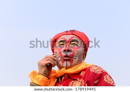 LUANNAN COUNTRY, CHINA - February 13, 2014: people wearing colorful clothes to yangko dance performances in square, hebei province