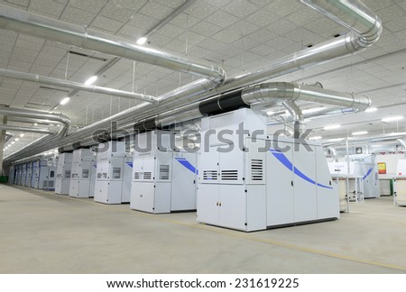 LUANNAN county - April 7: the factory is working within modern spinning equipment, ZeAo spinning co., LTD., on April 7, 2014, LUANNAN county, hebei province, China.