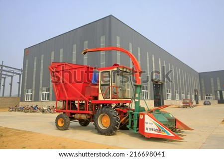 LUANNAN COUNTY -  AUGUST 16: red harvester outdoor show, in a manufacturing factory, on august 16, 2014, Luannan County, Hebei Province, China