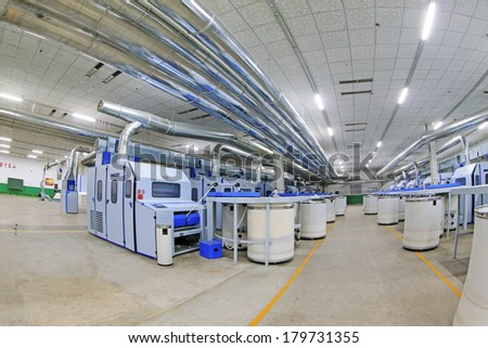 LUANNAN COUNTY - DECEMBER 20: Combed cotton production line and pipes in the ZeAo spinning LTD., on December 20, 2013, Luannan county, hebei province, China.