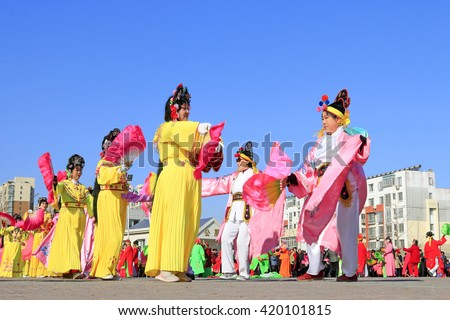 Luannan County- February 24: Chinese traditional style yangko folk dance performance in the street, on February 24, 2016, luannan County, hebei Province, China