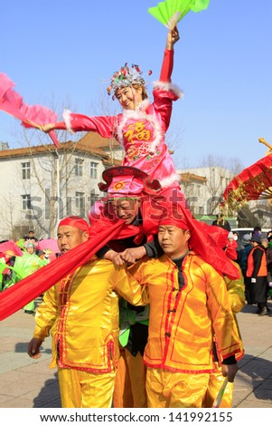 LUANNAN COUNTY - FEBRUARY 22: During the Chinese Lunar New Year, people wear colorful clothes, yangko dance performances in the streets, on February 22, 2013, Luannan County, Hebei Province, China.