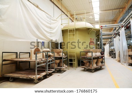 LUANNAN COUNTY - JANUARY 5: Pulp tank in the production line, in the ZhongTong Ceramics Co., Ltd. January 5, 2014, Luannan county, Hebei Province, China.
