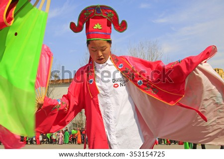 LUANNAN COUNTY - MARCH 4: traditional Chinese style yangko dance performances in the square, on march 4, 2015, Luannan County, Hebei province, China