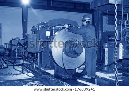 Luannan County - November 19: Worker busy working in production workshop, at Huifeng Steel Corp, on November 19, 2012. This is a large steel manufacturer in the local.