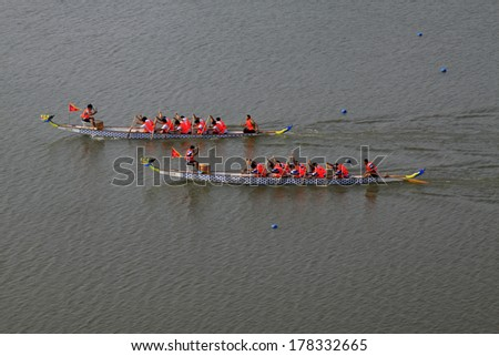 LUANNAN - JUNE 14: The dragon boat race scene in Chinese traditional Dragon Boat Festival on June 14, 2013, Luannan, Hebei Province, China.
