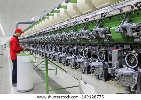 LUANNAN - MARCH 26: Machinery and equipment in a spinning production line in a spinning company, in March 26, 2013, Luannan County, Hebei Province, china.   - stock photo