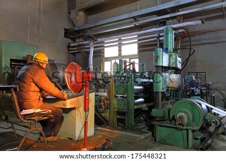 Luannan, November 19: A worker sitting at console operation, in Huifeng Steel Corp workshop, in November 19, 2012.