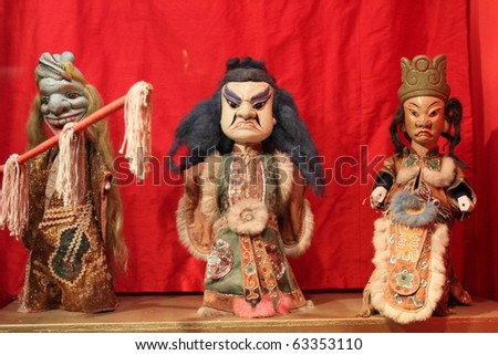 LUBECK - JUNE 8: medieval Chinese puppets perform puppet show at Theater Figuren on June 8, 2010 in Lubeck, Germany