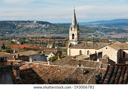 Luberon landscape view with cathedral of Bonnieux and Lacoste village in the back, Provence, France - stock photo