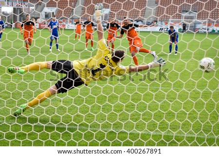 LUBIN, POLAND - APRIL 3, 2016: Filip Starzynski shot penalty kick during match Polish Premer League between KGHM Zaglebie Lubin - Piast Gliwice 4:1. - stock photo