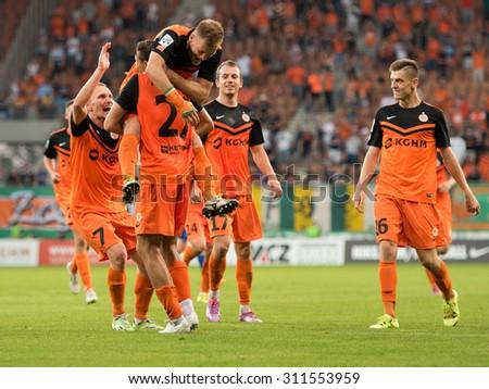 LUBIN, POLAND - AUGUST 29, 2015:  Players of KGHM Zaglebie Lubin after scoring goal during match Polish Premer League between KGHM Zaglebie Lubin - Ruch Chorzow (3:1). - stock photo
