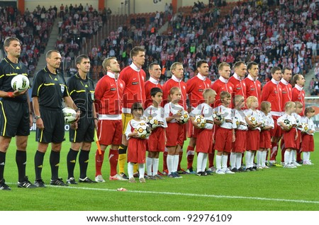 LUBIN, POLAND - AUGUST 10: Polish national team during the national anthem before match Poland - Georgia (1:0) at the stadium Dialog Arena on August 10, 2011 in Lubin, Poland. - stock photo