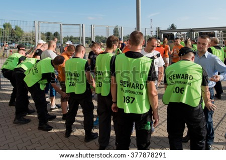 LUBIN, POLAND - AUGUST 29, 2015:  Security searches supporters at the entrance to the stadium before match Polish Premer League between KGHM Zaglebie Lubin - Ruch Chorzow (3:1).