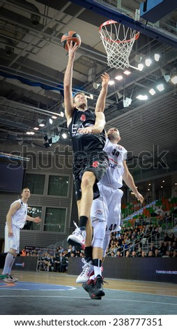 LUBIN, POLAND - DECEMBER 18, 2014: Angelo Gigli and Ivan Zigeranovic in action during the Euroleague basketball match between PGE Turow Zgorzelec - Emporio Armani Mediolan 96:101 - stock photo