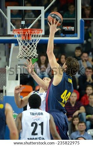 LUBIN, POLAND - DECEMBER 5, 2014:  Ante Tomic in action during the Euroleague basketball match between PGE Turow Zgorzelec - FC Barcelona 65:104. - stock photo