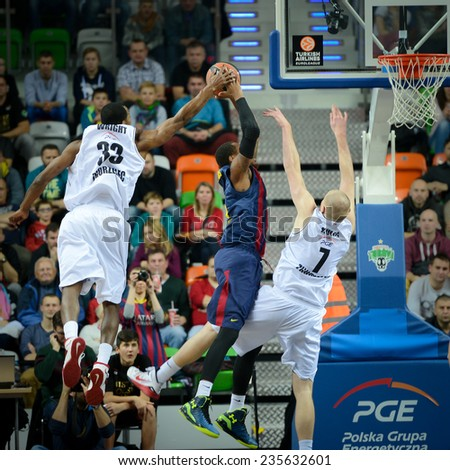 LUBIN, POLAND - DECEMBER 5, 2014: Chris Wright (L), Deshaun Thomas and Damian Kulig (R) in action during the Euroleague basketball match between PGE Turow Zgorzelec - FC Barcelona 65:104. - stock photo