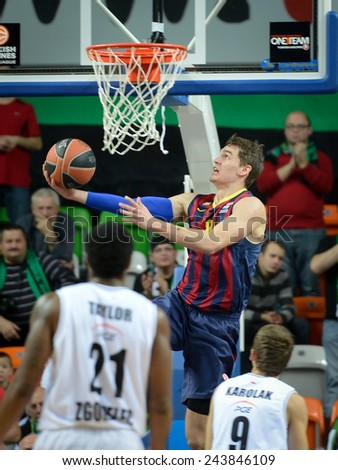 LUBIN, POLAND - DECEMBER 5, 2014:  Mario Hezonia (8) in action during the Euroleague basketball match between PGE Turow Zgorzelec - FC Barcelona 65:104. - stock photo
