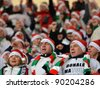 LUBIN, POLAND - DECEMBER 05, Match Polish Ekstraklasa between KGHM Zaglebie Lubin - Legia Warszawa 0:4. Cheering fans dressed up as St. Claus on December 05, 2011 in Lubin, Poland. - stock photo