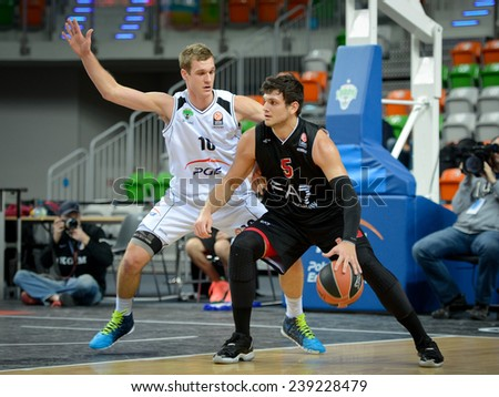 LUBIN, POLAND - DECEMBER 18, 2014:  Nemanja Jamaraz and Alessandro Gentile in action during the Euroleague basketball match between PGE Turow Zgorzelec - Emporio Armani Mediolan 96:101 - stock photo