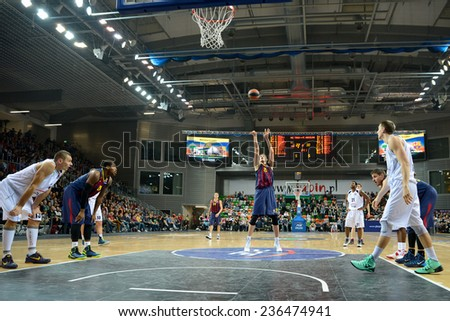 LUBIN, POLAND - DECEMBER 5, 2014: Tibor Pleiss scores penalty shot during the Euroleague basketball match between PGE Turow Zgorzelec - FC Barcelona 65:104. - stock photo