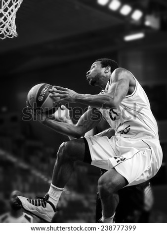 LUBIN, POLAND - DECEMBER 18, 2014: Tony Taylor in action during the Euroleague basketball match between PGE Turow Zgorzelec - Emporio Armani Mediolan - stock photo