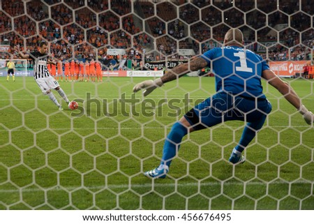 LUBIN, POLAND - JULY 21, 2016: Second Round Elimination to European League match KGHM Zaglebie Lubin - FK Partizan Belgrad 0:0 penalty 4:3. Penalty shotting Petar Durickovic, goalkeeper Martin Polacek - stock photo