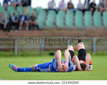 LUBIN, POLAND - JUNE 05; 2014: Michal Bierzalo (L) and Kamil Maternik (R) injured during match 1/4 final Polish Junior Championships betwen KGHM Zaglebie Lubin - Wisla Krakow(0:2). - stock photo