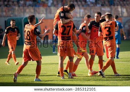 LUBIN, POLAND - JUNE 6, 2015: Team of KGHM Zaglebie after scoring goal during match Polish 1 League between KGHM Zaglebie Lubin - Termalica Bruk-Bet Nieciecza   1:1. - stock photo