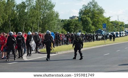 LUBIN, POLAND - MAY 31, 2014: fans of Widzew Lodz are escorted by the Police to the stadium  before match Polish Premier League between KGHM Zaglebie Lubin - Widzew Lodz. - stock photo