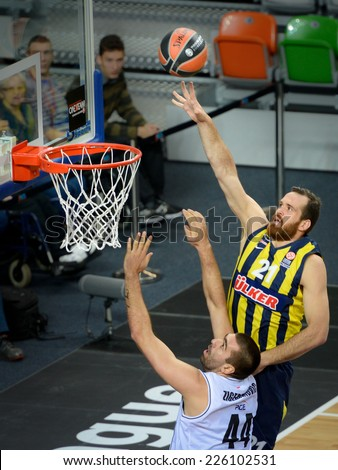 LUBIN, POLAND - OCTOBER 24, 2014: Ivan Zigeranovic (44) and Oguz Savas (21) in action during the Euroleague basketball match between PGE Turow Zgorzelec - Fenerbache Ulker Stambul 76:91. - stock photo