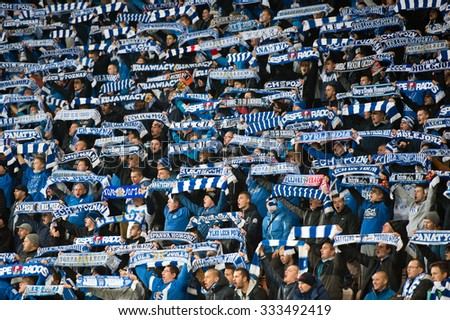 LUBIN, POLAND - OCTOBER 28, 2015: Supporters of Lech Poznan with scarfs during match Polish Cup between KGHM Zaglebie Lubin - Lech Poznan 0:1 - stock photo