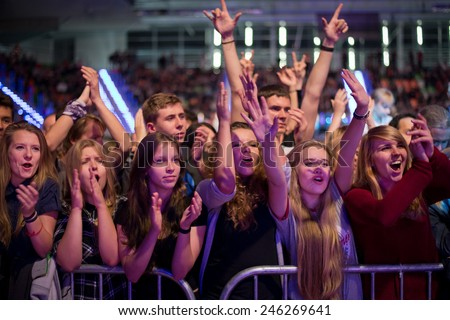 LUBIN, POLAND - SEPTEMBER 26, 2014: Fans during the concert band in the sports and entertainment hall. - stock photo