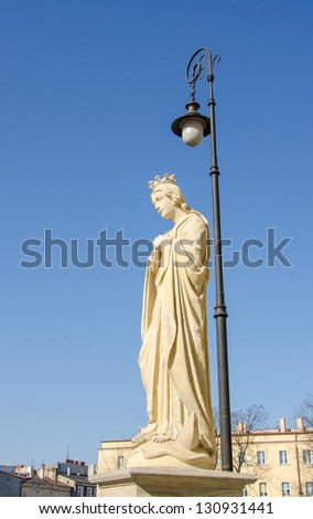 Lublin, Poland - statue of Virgin Mary in front of Archcathedral of St. John the Baptist - stock photo