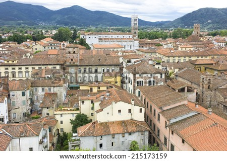 LUCA, ITALY - MAY 7, 2014: Typical terracotta roofs in view in Italian town Lucca, May 7, 2014 - stock photo