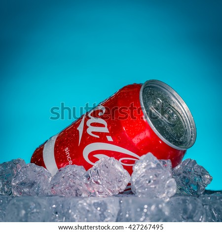 LUCCA, ITALY-AUGUST 20, 2015: Can of Coca-Cola on ice. Coca-Cola is a carbonated soft drink sold in stores, restaurants, and vending machines throughout the world.