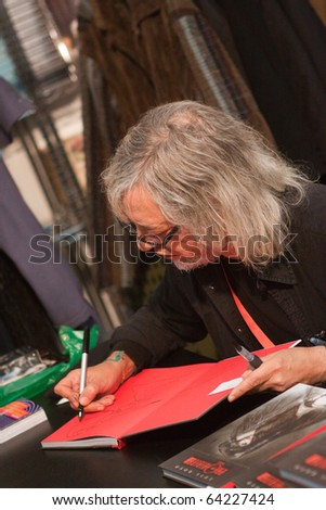 LUCCA, ITALY - OCTOBER 30: spanish illustrator Luis Royo signs autograph at Lucca Comic sand Games 2010 fair on October 30, 2010 in Lucca, Italy.
